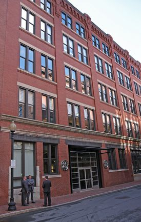 General Electric's temporary headquarters in the Fort Point neighborhood of Boston. The company announced a $15 million gift to support community health in the region.