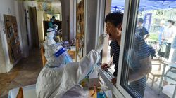 A resident gets tested for COVID in Nanjing in Jiangsu province on Aug. 2.