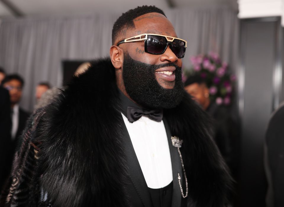 Rick Ross went for black fur over his black tuxedo, gold-trim shades in place.
