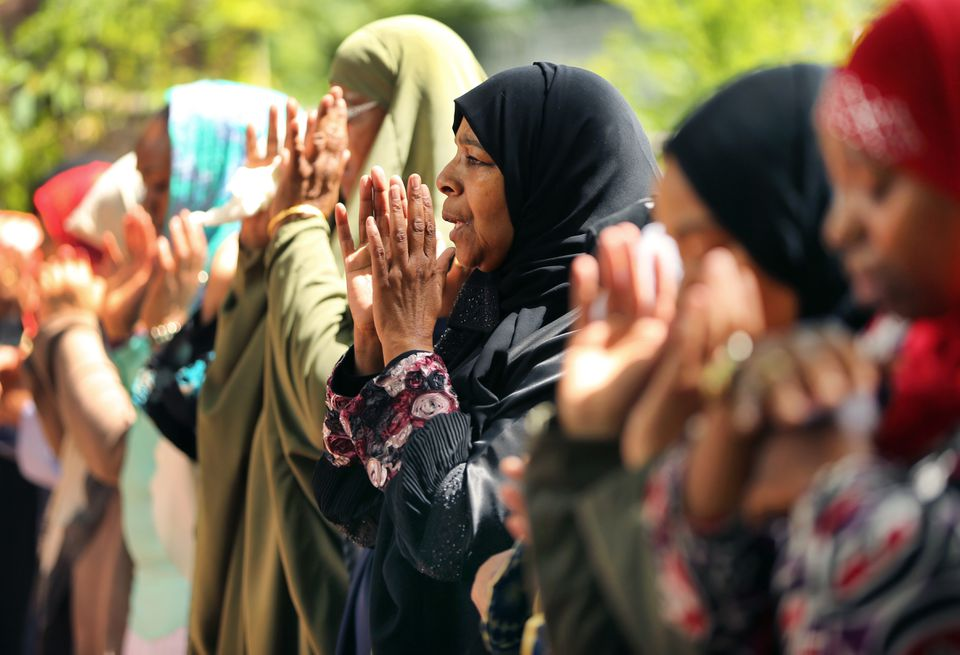 Rahimah Rahim (center) prayed during the funeral service for her son Usaama Rahim at the Mosque for the Praising of Allah.