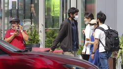 Pedestrians wore masks Thursday in Cambridge, where officials urged residents and visitors to wear masks in indoor public spaces.