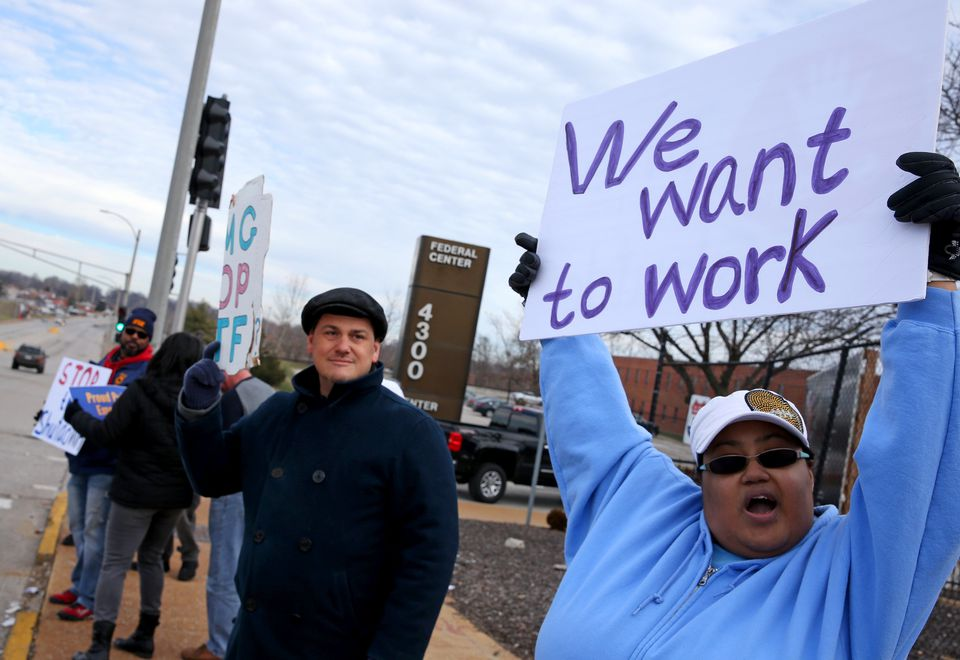 Emma James (right), and co-worker Vincent Cuenca demonstrated outside the Federal Center in St. Louis. James is a processor in the multifamily housing division while Cuenta processes payments to FEMA contractors.