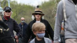 Some people wore masks in the Public Garden and some did not on April 30 in Boston.