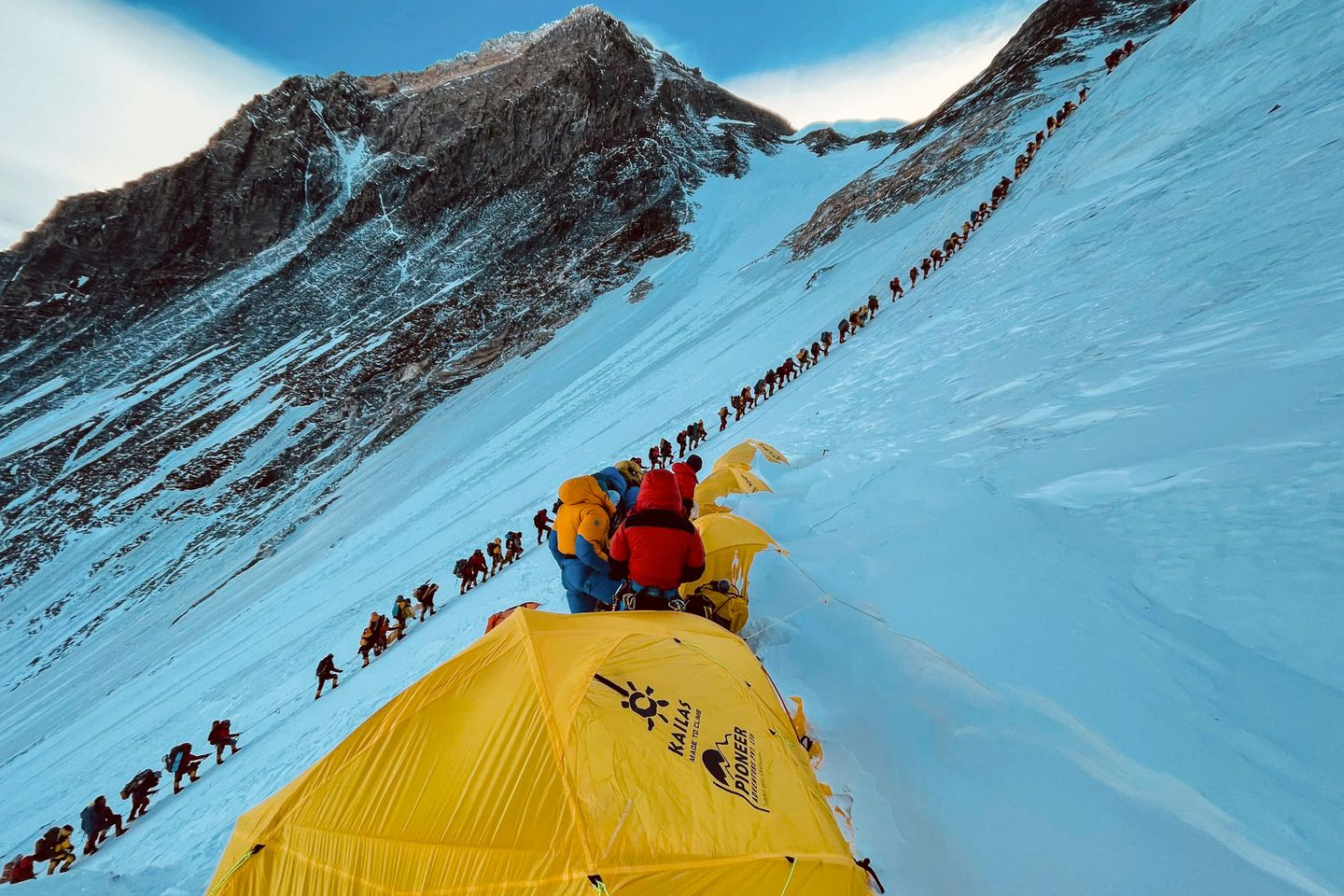 Mountaineers lined up as they climb a slope during their ascend to summit Mount Everest, in Nepal.