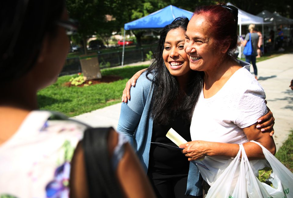 State Representative Juana Matias (left)  met with voters at Lowell Farmers' Market in August.