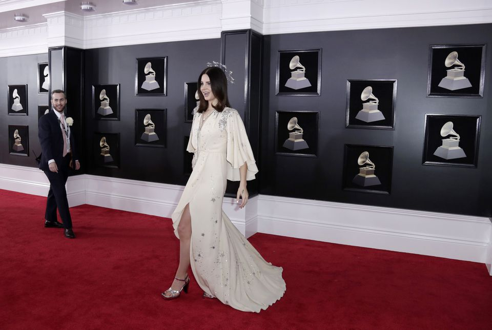 Lana Del Rey was an angel in off-white with a high slit and star theme, including a silver star head piece.