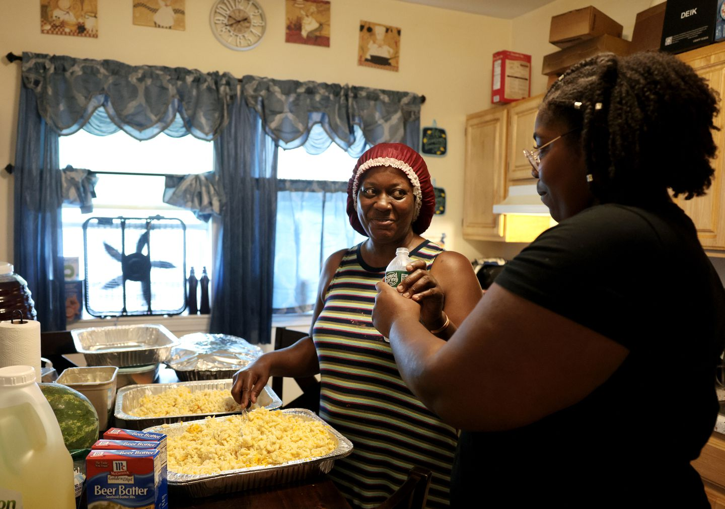 Bonita Cuff (left) and her daughter Janaya, 21, helped prepare food for a church cookout.