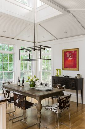 A three-season porch next to the kitchen was replaced with a dining area with vaulted ceilings and clerestory windows at the apex.