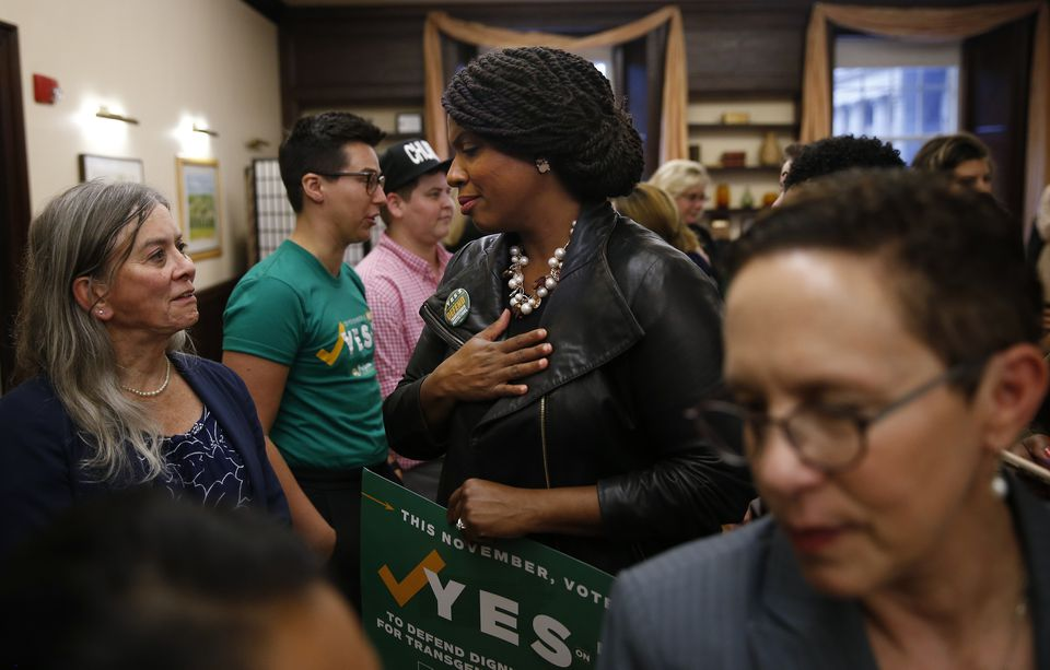 Democratic congressional nominee Ayanna Pressley (center)spoke with Sara Schnorr, (left) a transgender attorney.