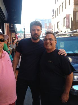 Ben Affleck, pictured with Paul Barker, owner of Pauli's in the North End, on Thursday.