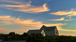 Wispy clouds above the Madaket section of Nantucket at sunset.