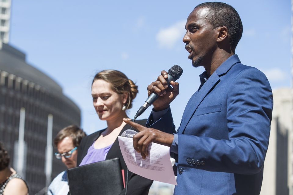 """Said Ahmed of the United Somali Youth spoke during a news conference to draw attention to government agencies' plans for """"Countering Violent Extremism"""" programs on the steps of Boston City Hall Thursday."""