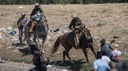 US Customs and Border Protection mounted officers attempted to contain migrants as they cross the Rio Grande from Ciudad Acuña, Mexico, into Del Rio, Texas, on Sept. 19.