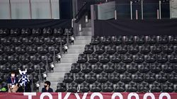 Empty seats are pictured in the arena during the badminton group stage matches at the Tokyo 2020 Olympic Games at the Musashino Forest Sports Plaza in Tokyo on Tuesday.