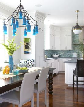 Every star needs a supporting cast. Here recessed and pendant lights fill in the darker spaces.