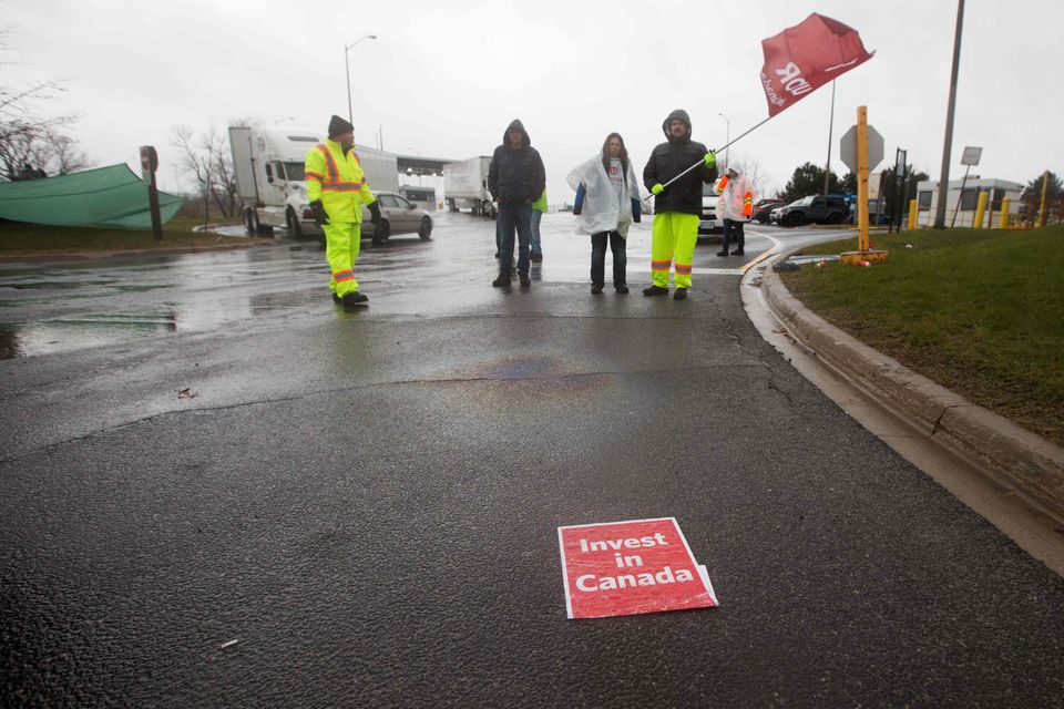 Union members blocked a gate 1 at the General Motors Oshawa plant in Oshawa, Ontario, on Monday.