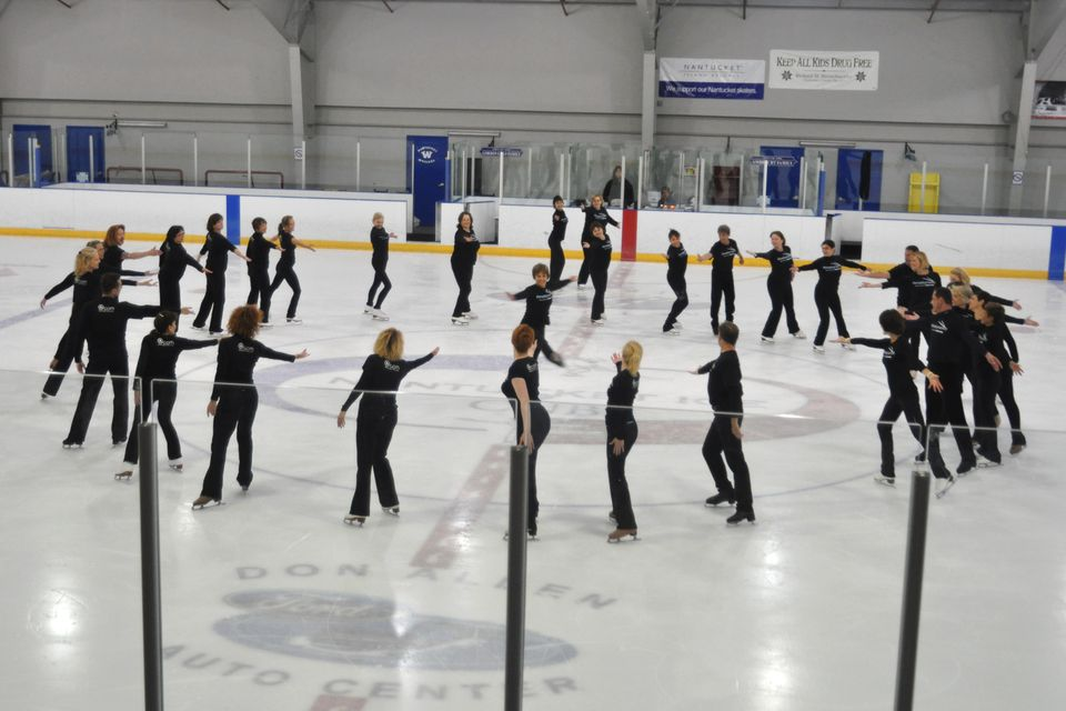 Skaters join Dorothy Hamill, center, and the coaches at the end of Hamill's Nantucket Skating Fantasy Camp last summer.