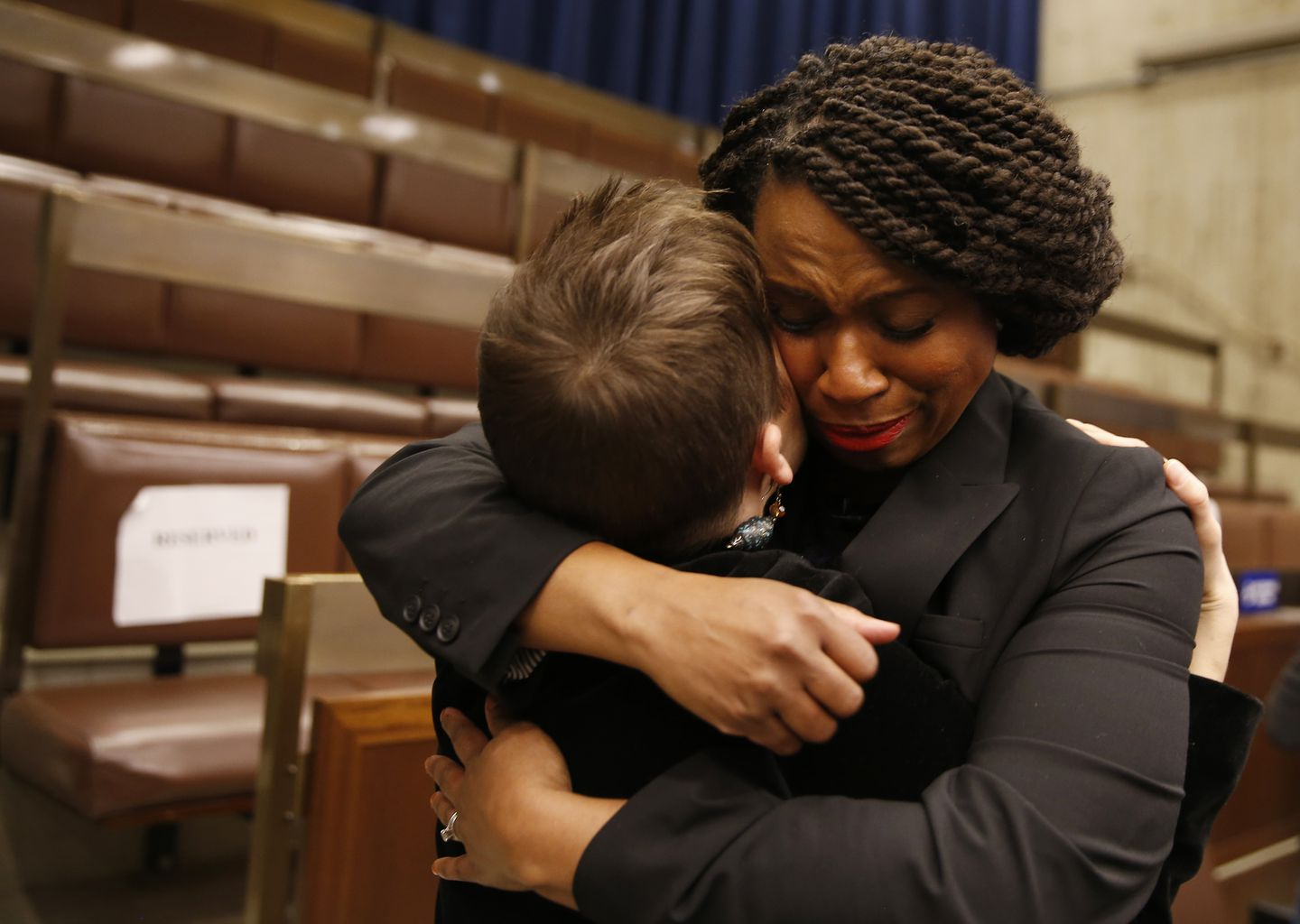 Ayanna Pressley embraced her former Chief of Staff Jessica Taubner (L) following a farewell at City Hall.
