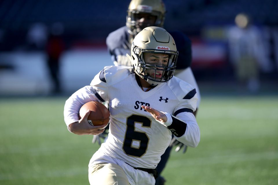 St. Bernard's Dom Cuevas carries the ball in the MIAA Division 8 Super Bowl Saturday against St. Mary's of Lynn.