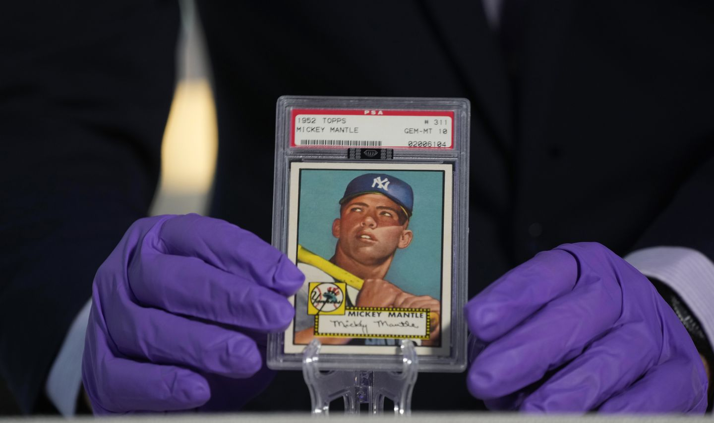 The 1952 Topps Mickey Mantle card is known as a Holy Grail of sports cards. It's shown here during a memorabilia exhibit ahead of the MLB All-Star Game in July in Denver.