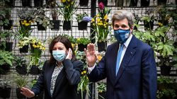 John Kerry, with Mayor Anne Hidalgo of Paris, has implored world leaders to double down on climate change mitigation.