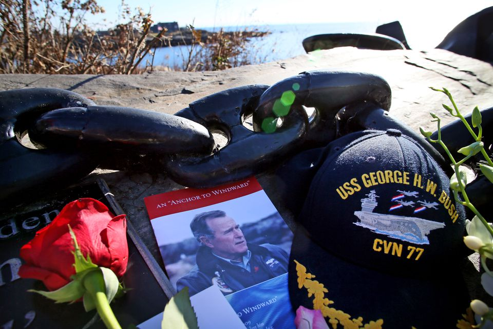 Visitors placed flowers and memorabilia at the overlook near Walker's Point, the Bush family compound, in Kennebunkport.
