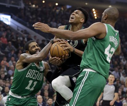 fa43b7b16ff2 Celtic Kyrie Irving had the upper hand on the Bucks  Giannis Antetokounmpo  on a first