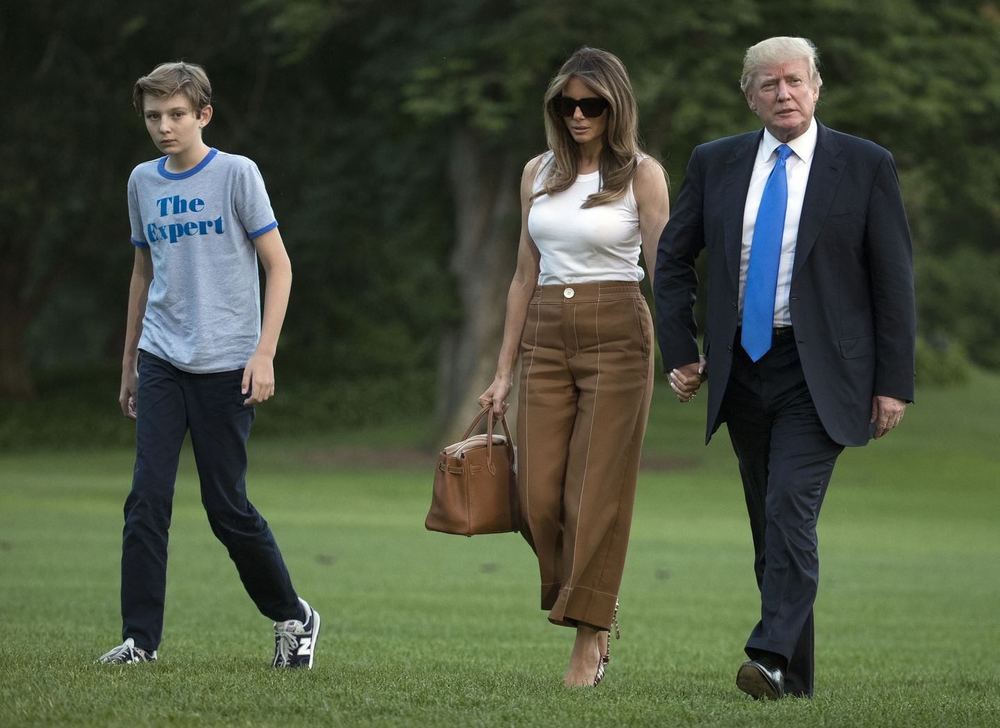 d032ccc9e6e6 Melania Trump (center) moved into the White House on June 11 and has mostly