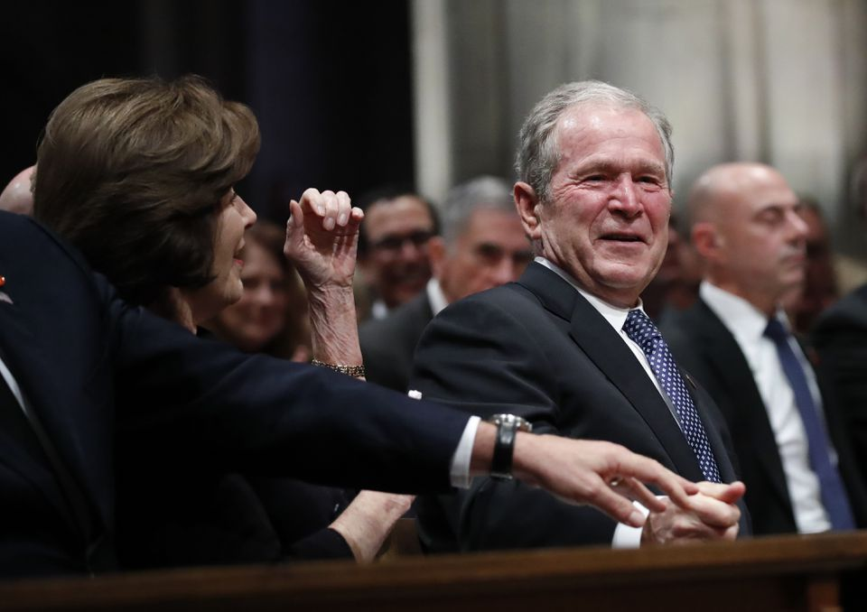 Former President George W. Bush smiled during the services for his father.
