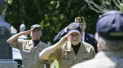 Middleborough Veterans Honor Guard member David Singer stands at attention before the ceremonial American flag folding at Russell Pittsley's funeral Saturday afternoon.