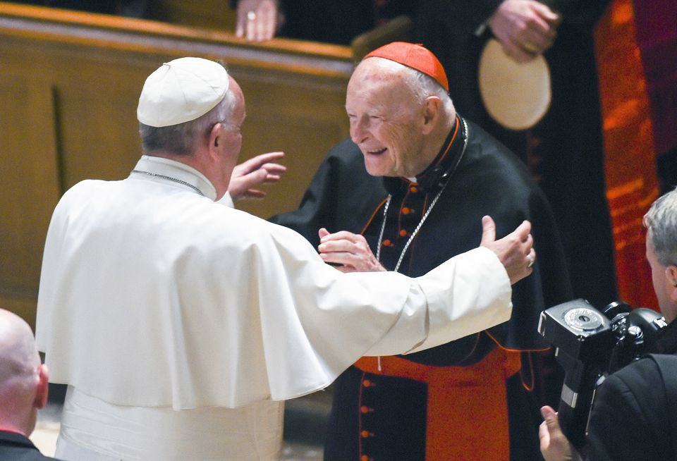 Pope Francis reaches out to hug US Cardinal Theodore Edgar McCarrick at the Cathedral of St. Matthew the Apostle in Washington, on Sept. 23, 2015. McCarrick resigned from the College of Cardinals in July.