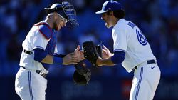 Jordan Romano (68) of the Toronto Blue Jays celebrates the win with catcher Danny Jansen (9) following against the Minnesota Twins at Rogers Centre on Sunday in Toronto.