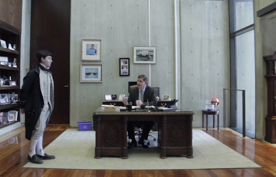 Mayor Martin J. Walsh spoke with an 18th-century patriot in his office in a scene from his campaign video.