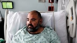 Victor Suero, 34, is treated for COVID-19 at Jackson Memorial Hospital in Miami, July 23, 2021. Doctors and nurses in the Florida hospital thought the onslaught of coronavirus admissions had ended.