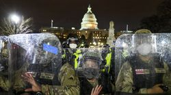 National Guard troops faced off with supporters of Donald Trump outside the US Capitol on Jan. 6, 2021.