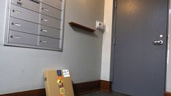 An Amazon package sits by the mailbox in a Chicago building.