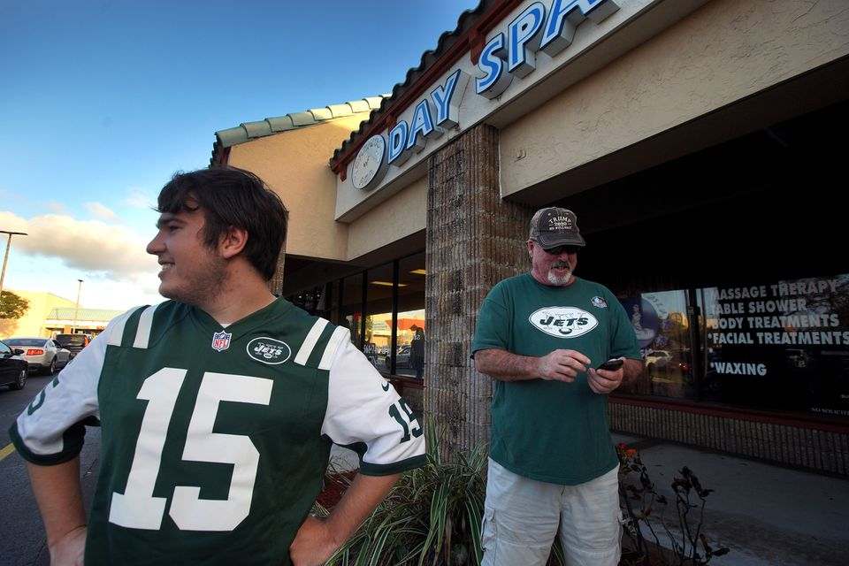 News of the Patriots owner being charged with solicitation of prostitution at Orchids of Asia Day Spa in Jupiter brought New York Jets fans Matthew Gizze and Mike Brown to the scene.
