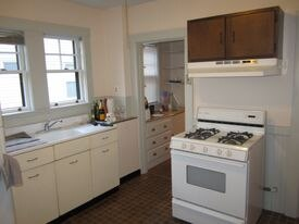 The original kitchen at Jim and Deb Miller's home. (Renovated kitchen shown above.)