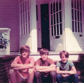 Charlie (left) and his two younger brothers outside their Needham home.