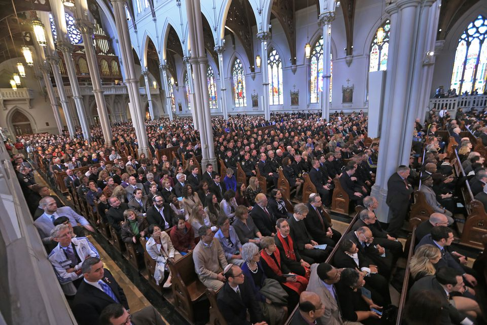 About 2,000 people packed the Cathedral of the Holy Cross in Boston to unite with clergy and political leaders and remember the victim's of Monday's bombings.