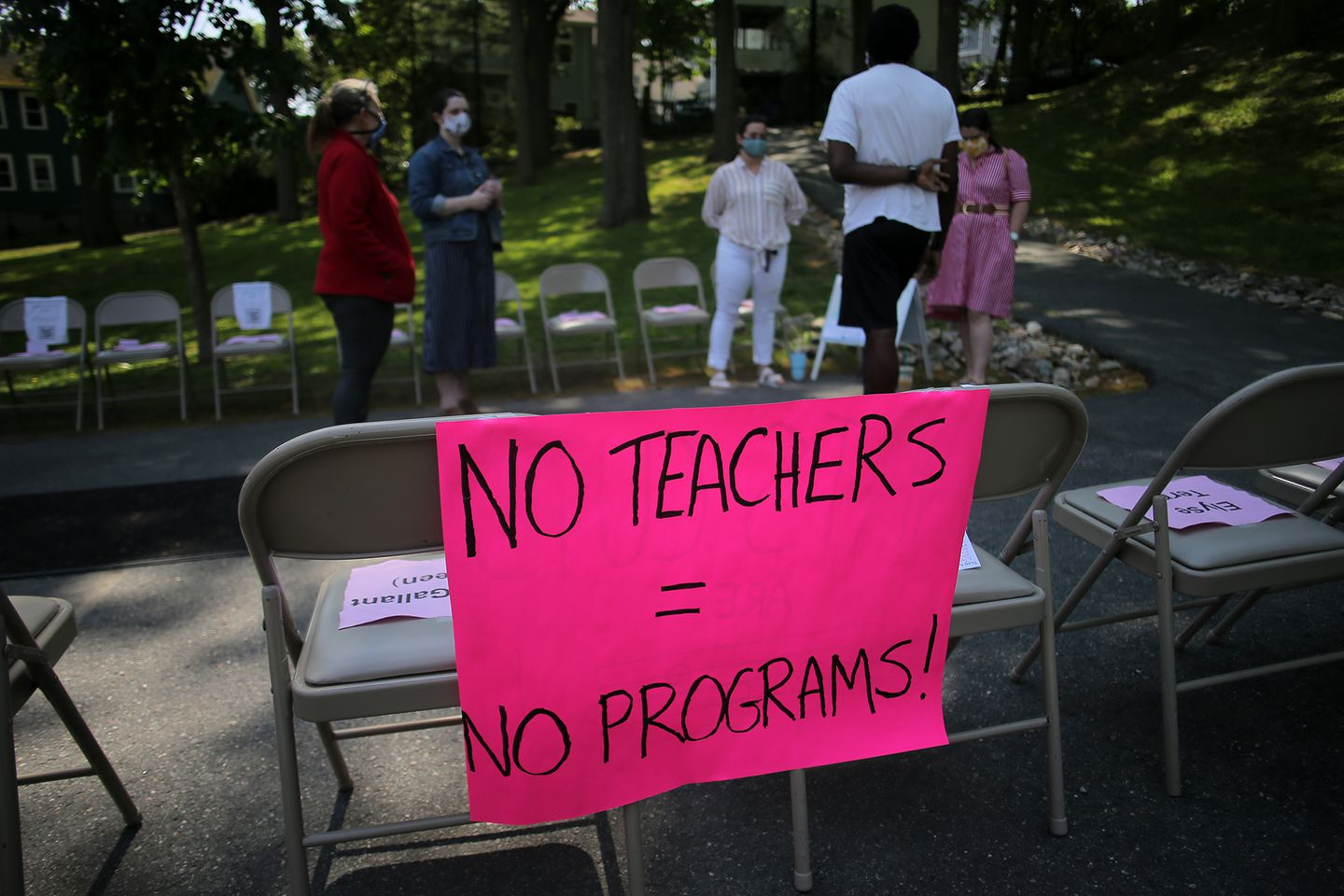 At a protest organized by high schoolers at the Health School in Brookline last week, signs listed the names of teachers who had received pink slips.