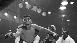 Muhammad Ali, still known as Cassius Clay, reacts to winning the world heavyweight boxing championship over Sonny Liston, on Feb. 25, 1964.