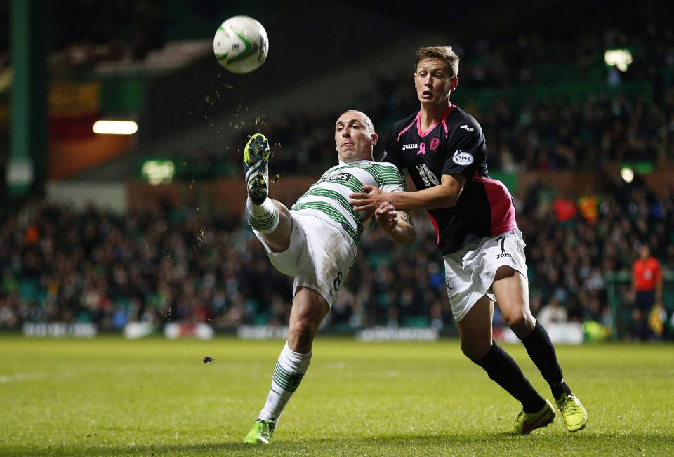 Celtic's Scott Brown (left) is challenged by Partick Thistle's James Craigen during their Scottish Premier League soccer match in Glasgow in December.