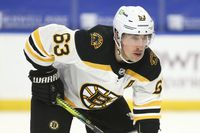 Profile photo of Brad Marchand wearing his helmet with a glass visor