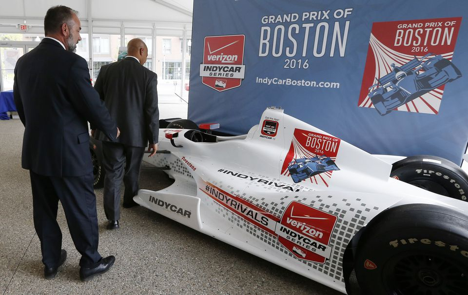 Boston executives examined an IndyCar mock-up in May of 2015.