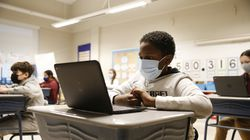 A student wore a mask as he sat in his fifth grade class at Mary L. Fonseca Elementary School in Fall River last fall.  (Jessica Rinaldi/Globe Staff)
