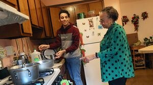 Manuel Coronado, a senior at Brighton High School, lives with his 78-year-old grandmother. He works in a Boston nursing home, navigating risk in the age of coronavirus.