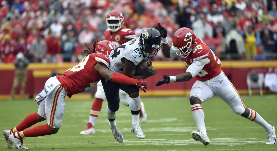 Jaguars running back T.J. Yeldon tries to split the Chiefs defenders Terrance Smith (left) and Dee Ford during Sunday's game.
