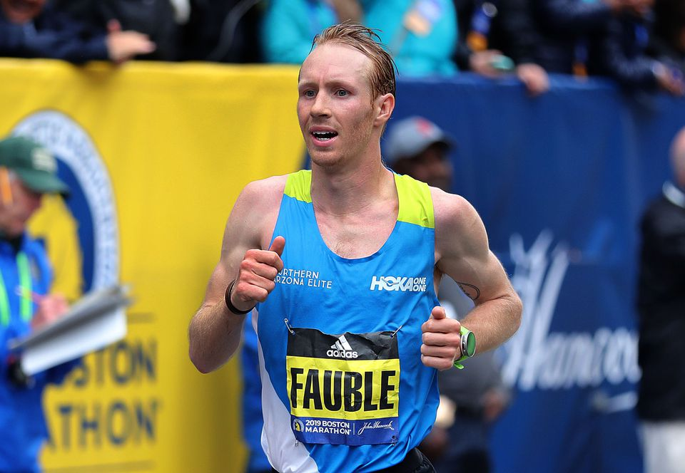 Scott Fauble's seventh-place finish was the top among American men, 16 seconds ahead of Jared Ward.