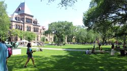 Students enjoyed the warm weather on Brown University's Main Green in August.